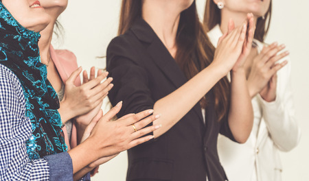 Business people applauding in a business meeting. Conference and presentation award concept.