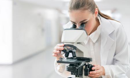 Scientist researcher using microscope in laboratory.