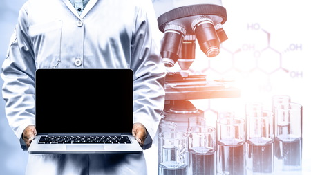 Research and development concept. Double exposure image of scientific and medical lab instrument Stock Photo