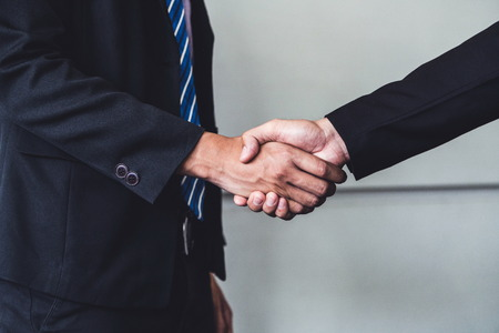 Business people agreement concept. Businessman do handshake with another businessman in the office meeting room. Banco de Imagens
