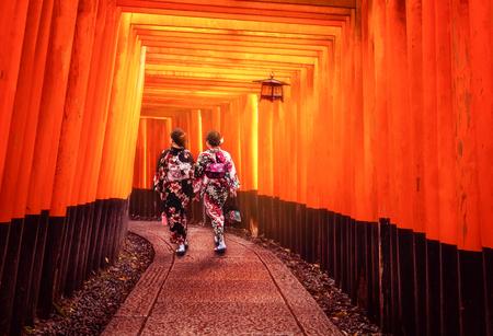 Kyoto, Japan Culture Travel - Asian traveler wearing traditional Japanese kimono walking in Fushimi Inari Shrine in the old town of Kyoto, Japan.