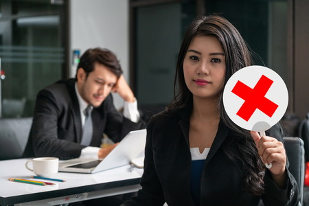 Female human resource manager decline the employment candidate who failed interviewing, sitting in office room. Reject job interview. Job application, recruitment and Asian labor hiring concept.