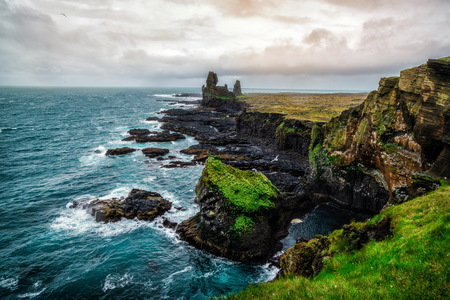 Londrangar in Snaefellsnes National Park, Iceland. Londrangar and hill Svalthufa are remains of a crater, which has been eroded to present form by sea. It is the tourist destination of west Iceland.