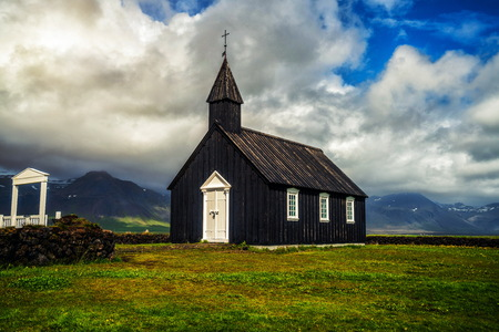 Budakirkja church in Snaefellsnes peninsula, Iceland. This black church sits alone in Budaahraun lava field, West of Iceland.
