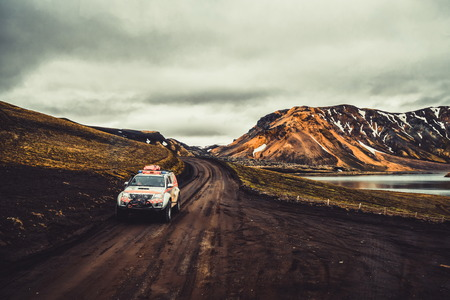 Landmannalaugar, Iceland - July 2, 2018: 4WD vehicle car travel off road in landscape of Landmannalaugar in highland of Iceland, Nordic, Europe. The place is famous for summer outdoor trekking way. Editorial