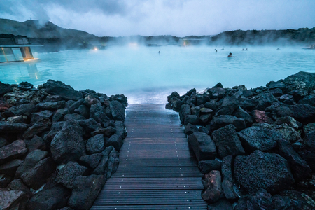 Reykjavik, Iceland - July 4, 2018: Beautiful geothermal spa pool in Blue Lagoon in Reykjavik. The Blue Lagoon geothermal spa is one of the most visited attractions in Iceland. Editöryel