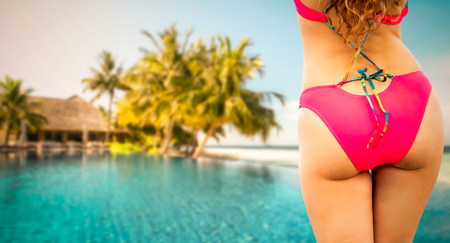Happy young woman wearing swimsuit at tropical sand beach resort in summer for holiday travel vacation. Imagens