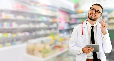 Pharmacist using tablet computer at the pharmacy. Medical healthcare and pharmaceutical staff service. Stock fotó