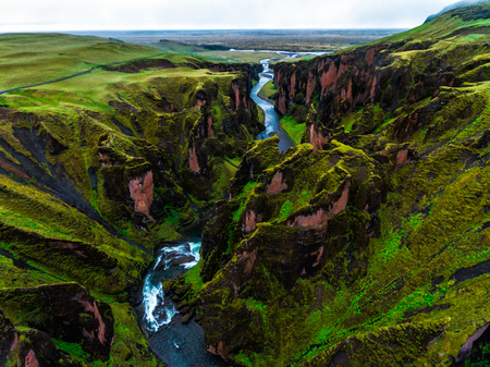 Unique landscape of Fjadrargljufur in Iceland. Top tourism destination. Fjadrargljufur Canyon is a massive canyon about 100 meters deep and about 2 kilometers long, located in South East of Iceland. Banco de Imagens