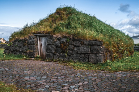 Ancient turf house in Iceland. Icelandic traditional building. Stok Fotoğraf