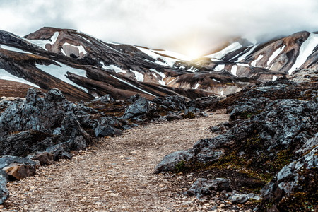 Landscape of Landmannalaugar surreal nature scenery in highland of Iceland, Nordic, Europe. Beautiful colorful snow mountain terrain famous for summer trekking adventure and outdoor walking.