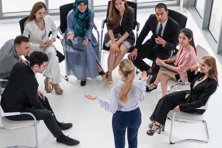Businesswomen and businessmen attending group meeting conference in office room. Corporate business team concept. Banco de Imagens