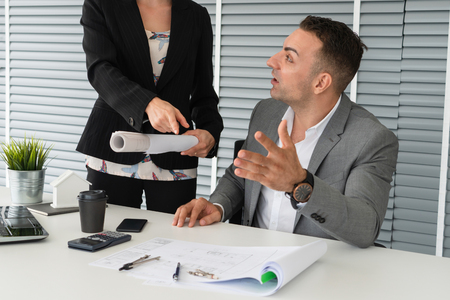Businessman executive checking work while meeting discussion with businesswoman worker in modern workplace office. People corporate business team concept.