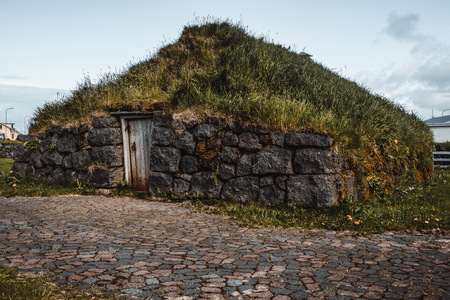 Ancient turf house in Iceland. Icelandic traditional building. Reklamní fotografie