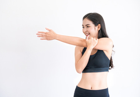 Strong and confident Asian woman in fitness gym. Healthy lifestyle concept.