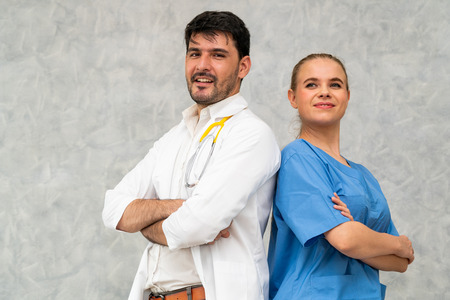 Doctor and nurse working in hospital. Healthcare and medical staff service concept. Stock Photo