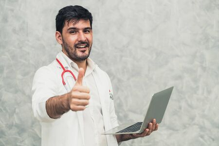 Doctor using laptop computer at the hospital. Medical healthcare and doctor staff service.
