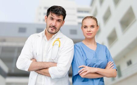 Doctors at hospital office working with another doctor. Healthcare and medical services. Stock fotó