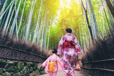 Kyoto, Japan Culture Travel - Asian traveler wearing traditional Japanese kimono walking in Arashiyama Bamboo Forest Grove in the old town of Kyoto, Japan. Zdjęcie Seryjne