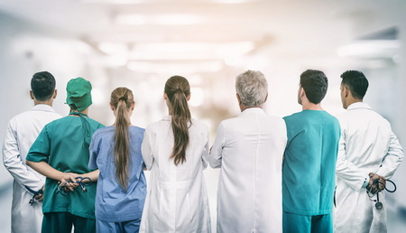 Healthcare profession teamwork and doctor service concept - International medical staff group of doctors, nurses and surgeon specialist standing with stethoscopes in the hospital. Stock fotó