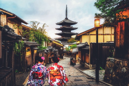Kyoto, Japan Culture Travel - Asian traveler wearing traditional Japanese kimono walking in Higashiyama district in the old town of Kyoto, Japan. Editorial