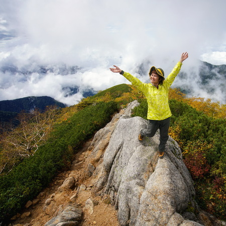 Epic adventure of hiker do trekking activity in mountain of Northern Japan Alps, Nagano, Japan, with panoramic nature mountain range landscape. Motivation leisure sport and discovery travel concept. Imagens