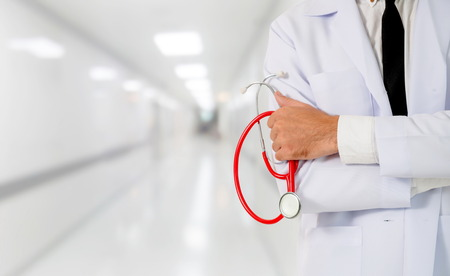Young male doctor working at the hospital. Medical healthcare and doctor staff service.