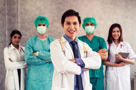 Healthcare people group. Professional doctor working in hospital office or clinic with other doctors, nurse and surgeon. Medical technology research institute and doctor staff service concept. - Image