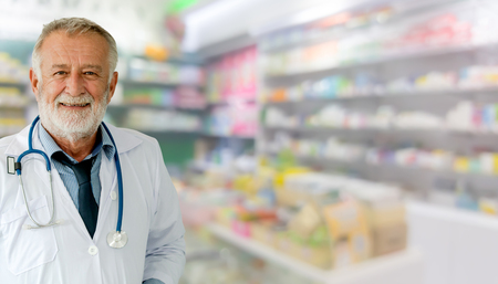 Senior male pharmacist working at the pharmacy. Medical healthcare and pharmaceutical service. Stock fotó