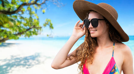 Happy young woman wearing swimsuit at tropical sand beach resort in summer for holiday travel vacation. Stock Photo
