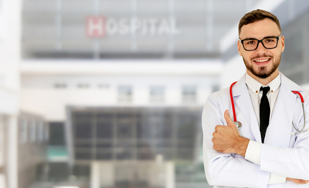 Young male doctor working at the hospital. Medical healthcare and doctor staff service. Stockfoto - 124823579