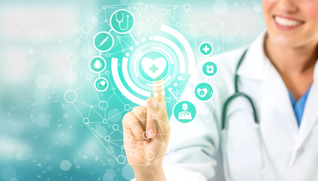 Medical Healthcare Concept - Doctor in hospital with digital medical icons graphic banner showing symbol of medicine, medical care people, emergency service network, doctor data of patient health. 版權商用圖片