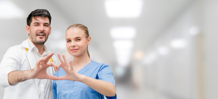 Doctors at hospital office working with another doctor. Healthcare and medical services. Stockfoto