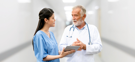 Senior doctor working with young doctor in the hospital. Medical healthcare staff and doctor service. Stockfoto - 124823750