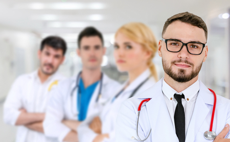 Healthcare people group. Professional doctor working in hospital office or clinic with other doctors, nurse and surgeon. Medical technology research institute and doctor staff service concept. Archivio Fotografico - 124824174