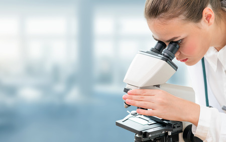 Scientist researcher using microscope in laboratory. Medical healthcare technology and pharmaceutical research and development concept. Reklamní fotografie