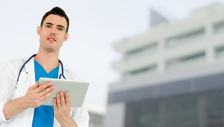 Doctor using tablet computer at the hospital. Medical healthcare and doctor staff service. Stockfoto