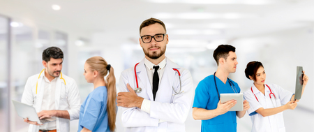 Healthcare people group. Professional doctor working in hospital office or clinic with other doctors, nurse and surgeon. Medical technology research institute and doctor staff service concept. Reklamní fotografie - 124824414