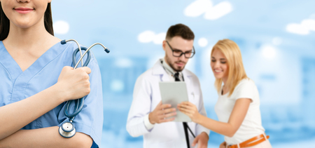 Healthcare people group. Professional doctor working in hospital office or clinic with other doctors, nurse and surgeon. Medical technology research institute and doctor staff service concept. Reklamní fotografie - 124824434