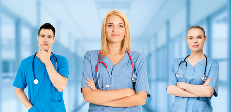 Healthcare people group. Professional doctor working in hospital office or clinic with other doctors, nurse and surgeon. Medical technology research institute and doctor staff service concept. Reklamní fotografie - 124824435