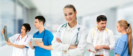 Healthcare people group. Professional doctor working in hospital office or clinic with other doctors, nurse and surgeon. Medical technology research institute and doctor staff service concept. Archivio Fotografico - 124824440