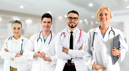 Healthcare people group. Professional doctor working in hospital office or clinic with other doctors, nurse and surgeon. Medical technology research institute and doctor staff service concept. Reklamní fotografie - 124824447