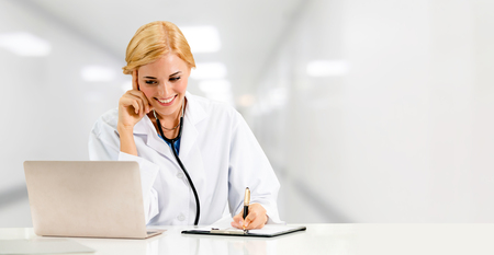 Doctor using laptop computer at the hospital. Medical healthcare and doctor staff service. Reklamní fotografie - 124824455
