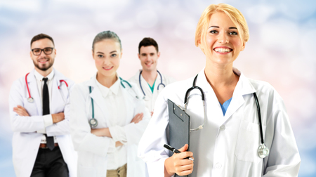 Healthcare people group. Professional doctor working in hospital office or clinic with other doctors, nurse and surgeon. Medical technology research institute and doctor staff service concept. Reklamní fotografie - 124824472
