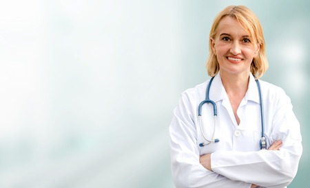 Senior woman doctor working in the hospital. Medical healthcare and doctor service. Reklamní fotografie - 124824482