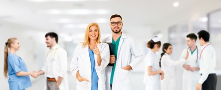 Healthcare people group. Professional doctor working in hospital office or clinic with other doctors, nurse and surgeon. Medical technology research institute and doctor staff service concept. Reklamní fotografie - 124824501