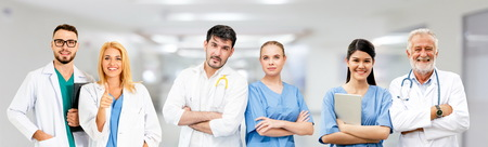 Healthcare people group. Professional doctor working in hospital office or clinic with other doctors, nurse and surgeon. Medical technology research institute and doctor staff service concept. Reklamní fotografie - 124824504