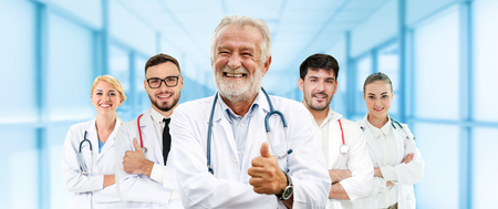 Healthcare people group. Professional doctor working in hospital office or clinic with other doctors, nurse and surgeon. Medical technology research institute and doctor staff service concept. Reklamní fotografie - 124824509