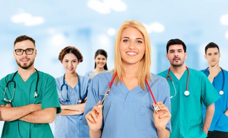 Healthcare people group. Professional doctor working in hospital office or clinic with other doctors, nurse and surgeon. Medical technology research institute and doctor staff service concept. Reklamní fotografie - 124824515