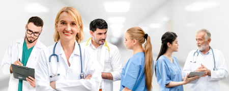Healthcare people group. Professional doctor working in hospital office or clinic with other doctors, nurse and surgeon. Medical technology research institute and doctor staff service concept. Reklamní fotografie - 124824528